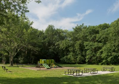 Picnic Area with Tables and Playground at Maple Shade, NJ Apartment